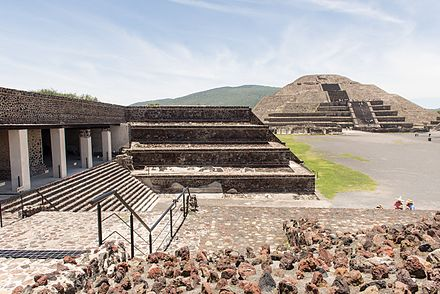 View of the Pyramid of the Moon and entrance to the Quetzalpapalotl Palace. During its peak in the Classic era, Teotihuacan dominated the Valley of Mexico and exerted political and cultural influence in other areas, such as in the Peten Basin. 15-07-13-Teotihuacan-RalfR-WMA 0257.jpg