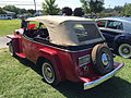 1951 Willys Jeepster 4-cylinder in red and black with white top at 2015 Macungie show 2of5.jpg