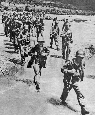 No Gun Ri massacre - An unidentified unit of U.S. 1st Cavalry Division troops withdraws southward on July 29, 1950, the day that a division battalion pulled back from No Gun Ri after killing large numbers of trapped South Korean refugees there.