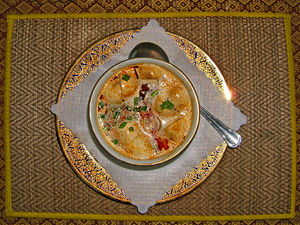 Thai chicken soup with galangal, coconut and m...