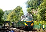 2011-08-15 diesel loc 210077 from PFT heritage-railway leaving Dorinne-Durnal station with M1-M2 carriages.jpg