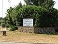 2018-07-26 Entrance sign, Woodland Holiday Park, Trimingham.JPG