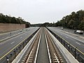 2018-10-26 11 42 51 View east along Virginia State Route 267 (Dulles Toll and Access Roads) and the Silver Line of the Washington Metro from the overpass for Virginia State Route 676 (Trap Road) in Wolf Trap, Fairfax County, Virginia.jpg