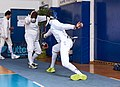 2nd Leonidas Pirgos Fencing Tournament. The fencer on the right scores a hand touch on the fencer on the left.jpg