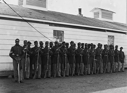 Soldiers of the Fourth United States Colored Infantry at Fort Lincoln, 1865 4th United States Colored Infantry.jpg