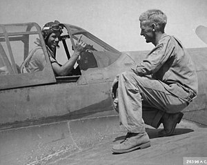 59th Test and Evaluation Squadron - A P-40 pilot of the squadron holds up a finger to tell his crew chief that he has downed a German plane, Paestum airfield, 15 September 1943