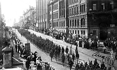 American troops marching on Vladivostok following the Allied Intervention in the Russian Civil War, 1918 5 U.S. Wolfhounds on parade in Vladavostock, August 1918.jpg