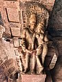 6th century amorous couple on pillar top looking below in Cave 3, Badami Hindu cave temple Karnataka 6.jpg