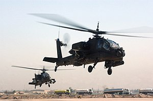 Two U.S. Army AH-64s after taking off from Cam...