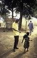ASC Leiden - van Achterberg Collection - 1 - 082 - Deux hommes, membres de MBOSCUDA, auto-organisation mbororo, avec un enfant - Bamenda, Cameroun - 6-12 février 1997.tiff