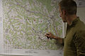 A Norwegian soldier studies a map for an operations brief during a military adviser team (MAT) and police adviser team (PAT) training exercise at the Hohenfels Training Area, a part of the Joint Multinational 131210-A-RJ750-002.jpg