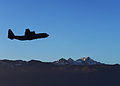 A U.S. Air Force C-130 Hercules aircraft transporting both Army and Air Force paratroopers flies over the flight line at Aviano Air Base, Italy, as part of airfield seizure training operations Dec. 10, 2013 131210-F-BH566-867.jpg