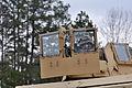 A U.S. Marine with Combat Logistics Battalion 6, 2nd Marine Logistics Group, based at Camp Lejeune, N.C., maneuvers through the improvised explosive device defeat lane, during the Enhanced Marksmanship Program 130321-A-SM601-234.jpg
