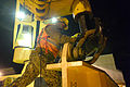 A U.S. Sailor with Navy Cargo Handling Battalion 1, based in Williamsburg, Va., prepares a crane to lift a modular warping tug from the deck of the container and roll-on-roll-off ship USNS 2nd Lt. John P. Bobo 130415-N-LO372-678.jpg
