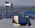 A section of the superstructure for the new CVF Queen Elizabeth Class Aircraft Carrier arrives at Rosyth in Scotland.jpg