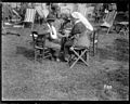 A wounded World War I soldier talking to a nurse at the garden party in the grounds of the New Zealand Stationary Hospital (21651389172).jpg