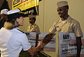 Admiral hands out scholarship money DVIDS319435.jpg