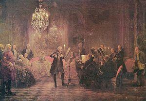 """""""O Concerto de Flauta de Sanssouci"""", por Adolph von Menzel, 1852, mostrando Frederico o Grande tocando flauta na sua sala de música em Sanssouci."""