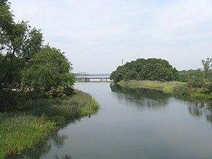Alley Pond Park - Creek, shown here at high tide, flows into Little Neck Bay, bridged by the Long Island Rail Road Port Washington Branch