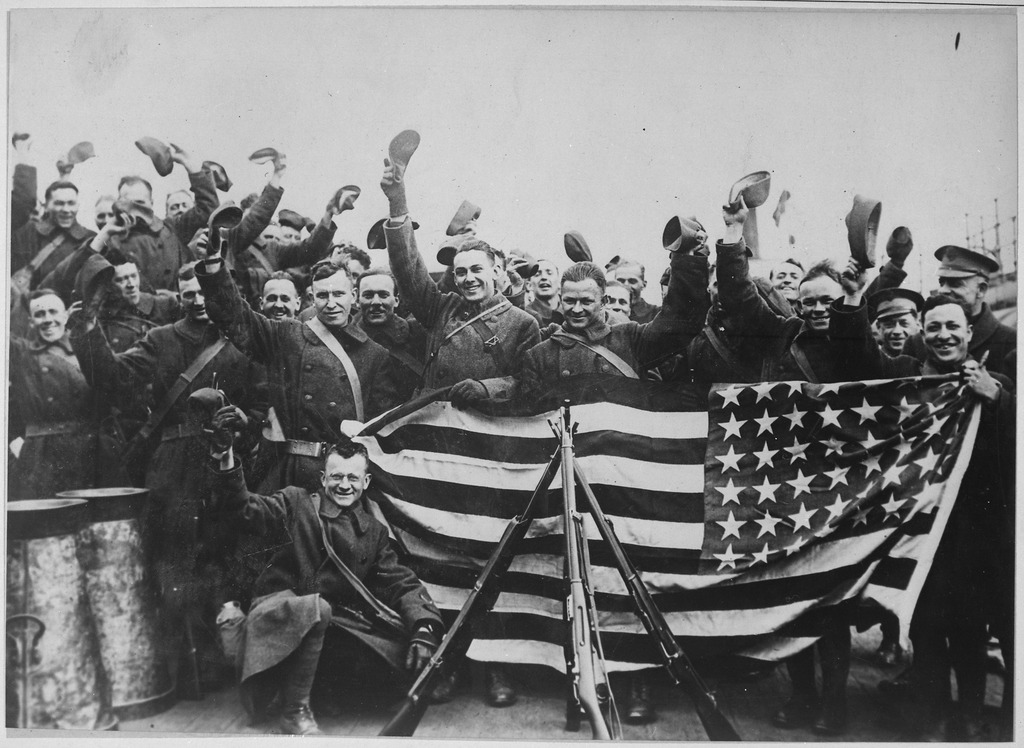 http://upload.wikimedia.org/wikipedia/commons/thumb/7/70/American_troops_in_Russian_port_about_to_leave_that_country._They_are_here_cheering_and_displaying_the_stars_and_stripes_-_NARA_-_533737.tif/lossy-page1-1024px-American_troops_in_Russian_port_about_to_leave_that_country._They_are_here_cheering_and_displaying_the_stars_and_stripes_-_NARA_-_533737.tif.jpg