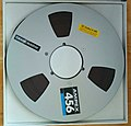 Ampex-branded 10-inch spool with magnetic tape (16886945165).jpg
