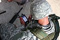 An Army medic accesses medical records using the MC4 handheld device..jpg