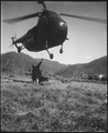 An HRS-1 Sikorsky helicopter hovers close to the ground while Marines hook a cargo net loaded with 1,000 pounds of... - NARA - 532420.tif