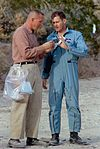 Apollo 11 Support Team members Jack Swigert (left) and Bill Pogue (right) discuss a sample during the Sierra Blanca geology trip.jpg
