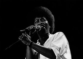 Joan Armatrading - Armatrading performing at the National Stadium, Dublin, Ireland, in the early 1980s
