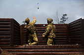 Australian Army soldiers throw a grenade RIMPAC Exercise 2014