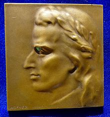Bronze-Plaque-Medal of Schiller's laureate head by the Austrian artist Otto Hofner [de] (Source: Wikimedia)