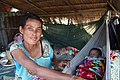 Baby in a hammock with mother in a hut in Laos.jpg