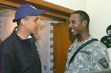 Obama speaking with a soldier stationed in Iraq, 2006 Barack Obama Iraq 2006.jpg