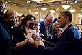 Barack Obama holds a child of a supporter, 2010.jpg