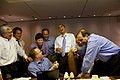 Barack Obama laughs with his staff on Air Force One.jpg