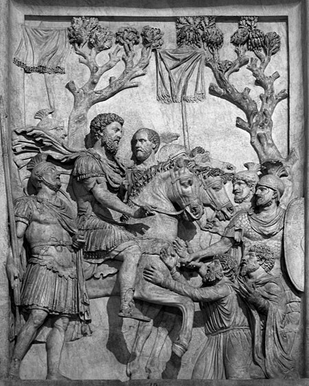Bas relief from Arch of Marcus Aurelius Marcus Aurelius showing his clemence to barbarii greyscale.jpg