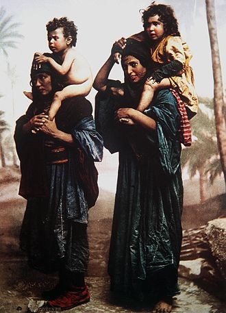 Bedouin - Bedouin mothers carrying their children on their shoulders. Color photo taken in the late 19th century by the French photographer Félix Bonfils.