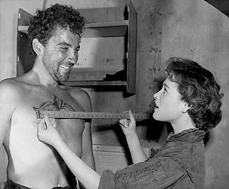Cameron Mitchell (actor) - Mitchell and Bella Darvi on the set of Hell and High Water (1954)