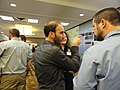Biologists explaining their poster at the Tuesday night poster session at the Northeast Region Biologists Conference. (5471416425).jpg