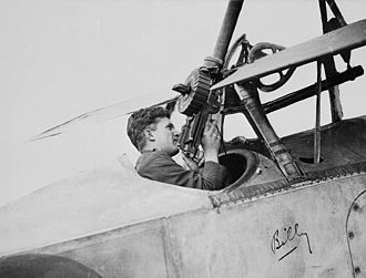 """Foster mounting - """"Billy"""" Bishop demonstrates use of Foster Mounting to fire upwards. The """"quadrant"""" of the mounting is visible immediately below the gun barrel."""