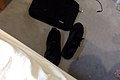 Black shoes and brief case on floor.jpg