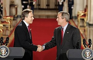 Tony Blair - Tony Blair and George W. Bush shake hands after their press conference in the East Room of the White House on 12 November 2004.