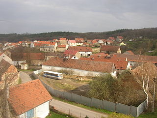 Village in Kladno county of Central Bohemian region