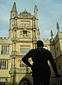 Bodleian Library - Tower of Five Orders from behind statue of Sir Bodley.jpg