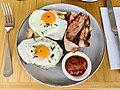 Breakfast in Australia; bacon and fried eggs on toast.jpg