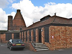 Brick built industrial buildings with conical chimeny