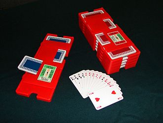 Board (bridge) - Stacked plastic boards with cards inserted