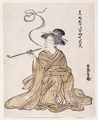 Smoking in Japan - E-Goyomi (Lady Smoking) Woodblock print believed to be by Korinsai, dating between 1785 and 1790. She is smoking with a long kiseru.