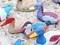 CARE International - Display of 196 papier-maché ducks painted on by 300 French children (23217171210).jpg