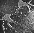 Caasement Flood Plain and Muir Inlet, outwash plains, glacial remnents, and icebergs in the inlet, August 24, 1963 (GLACIERS 5317).jpg